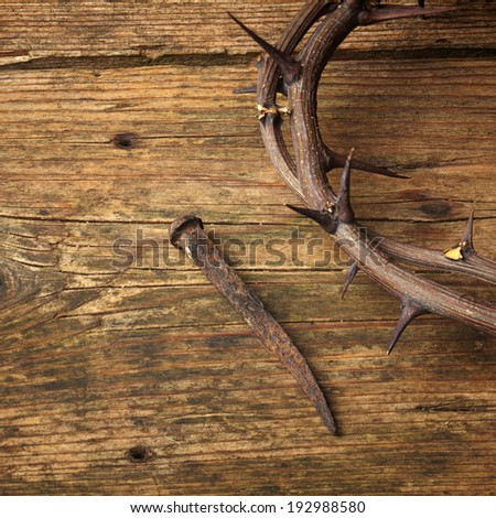 week of passion. Jesus Christ crown of thorns and a nail on wooden background - stock photo