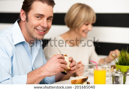 Weekend outing, couple enjoying a meal - stock photo