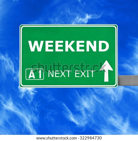 WEEKEND road sign against clear blue sky - stock photo