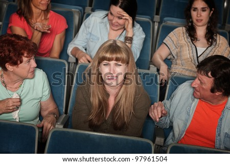 Weeping woman and distracted people in the audience - stock photo
