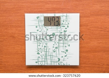 Weighed scale digital show 47 kg. It on wood floor. - stock photo