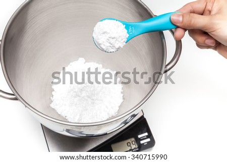 Weighing flour on the digital scale - stock photo
