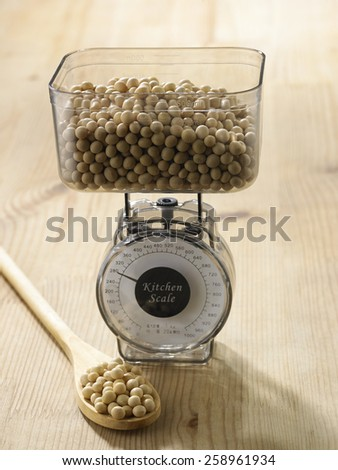 weighing the amount of soy beans