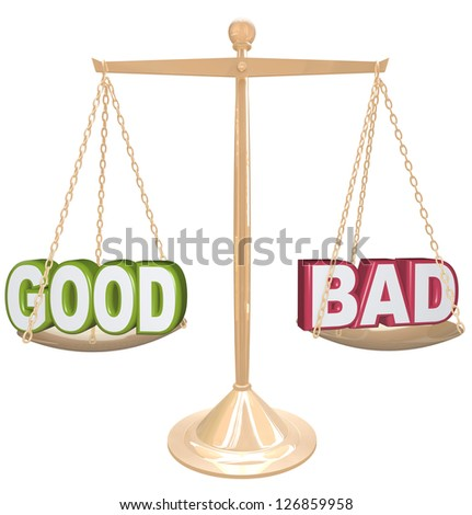 Weighing the good and bad of a situation or issue on a gold metal scale, one word on each side, measuring the positives and negatives - stock photo