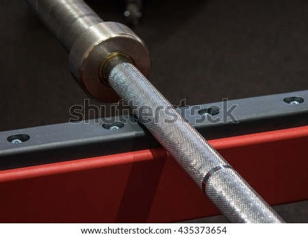 weight lifting bar on the rack  in a  fitness center - stock photo