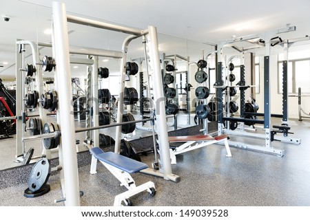 Weight lifting equipments in a club gym.