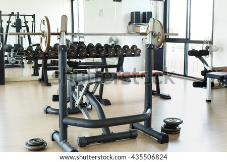 Weight lifting in fitness gym.Indoor sport club.