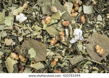 weight loss and detox herbal tea with oolong tea, lotus leaf, rice tea, green tea, Buddha tea,lemon balm and balsam pear - closeup background - stock photo