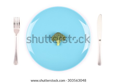 Weight loss challenge. Diet concept image of broccoli on a blue plate - stock photo