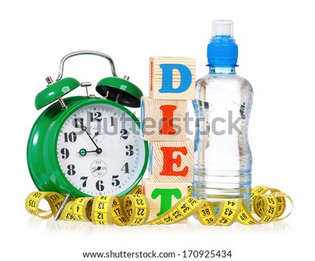 Weight loss concept - green alarm-clock and yellow tape measure with water bottle, isolated on white background  - stock photo