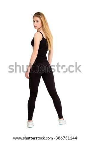 Weight-loss, diet concept - slim thin athletic young beautiful blonde woman shows her good shape isolated at white background. Fitness woman. Slimming and dieting. Good shape figure - stock photo