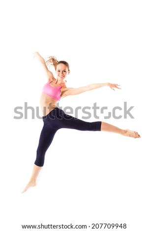 Weight loss fitness woman jumping of joy.
