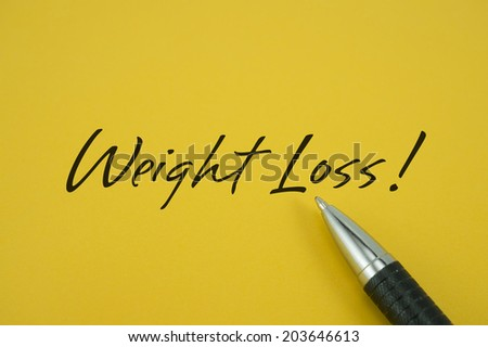 Weight Loss! note with pen on yellow background