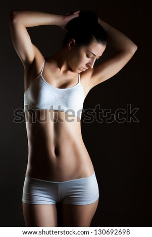 Weight Loss Woman, isolated on black background - stock photo