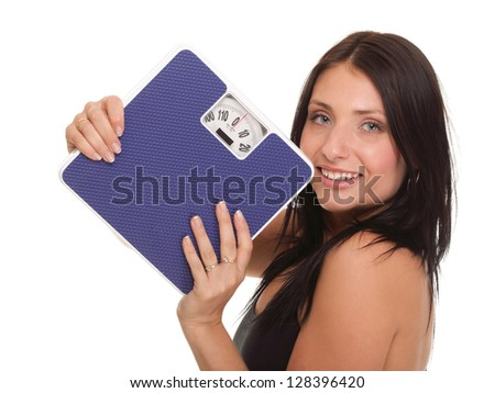 Weight loss woman on scale happy on scales over white - stock photo
