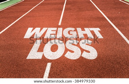 Weight Loss written on running track - stock photo