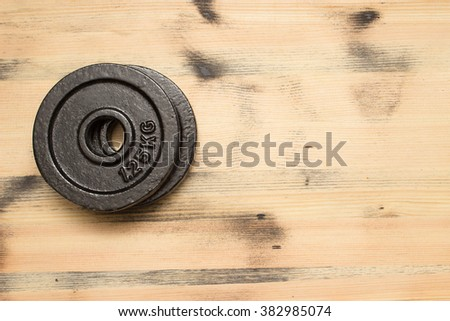 Weight on the wooden background