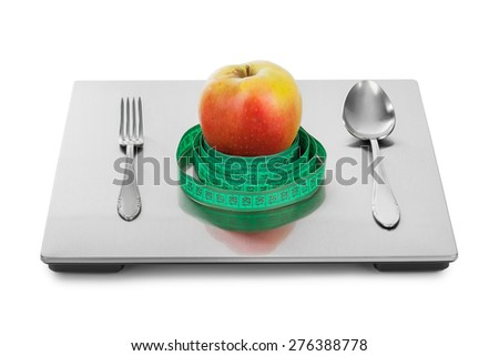 Weight scale and fruits isolated on white background - stock photo
