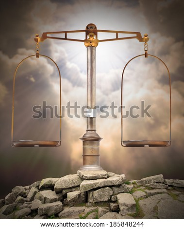 Weight scale on the peak against heaven. Divine justice concept. - stock photo