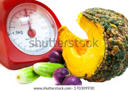 weight scale with vetgetable  - stock photo