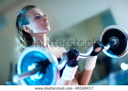 Weight training young woman portrait.