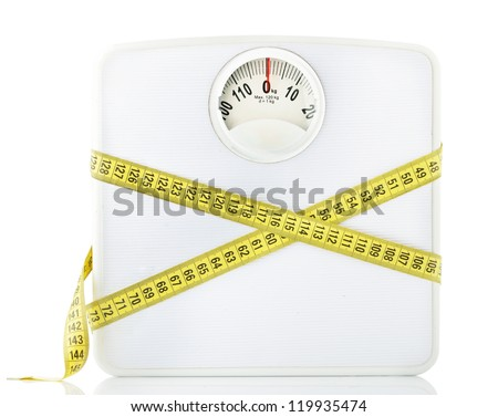 Weighting scales with a measuring tape - stock photo