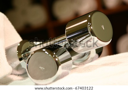 Weights on white towel - stock photo