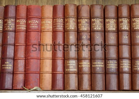 WEIMAR, GERMANY - APRIL 12, 2016. Collection of old books by Balzac in German language on a bookshelf.