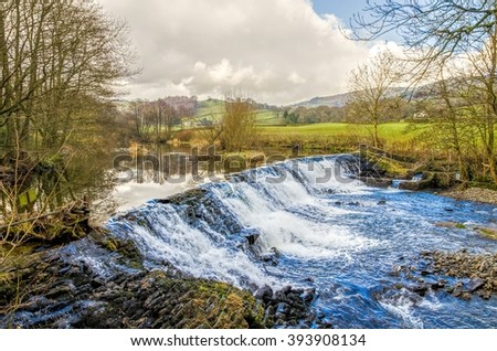 Weir on River Kent, Cumbria, England  - stock photo