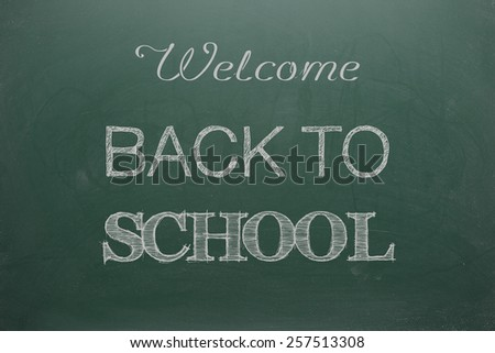 Welcome Back To School Sign On Green Board - stock photo