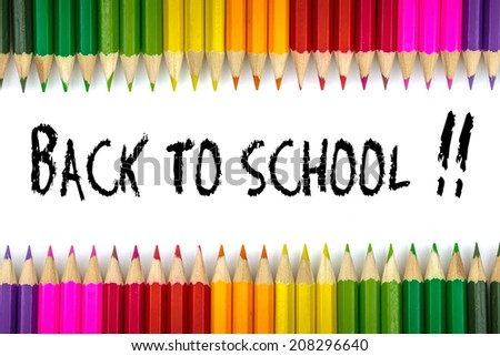 Welcome back to school written on a sheet of paper school with colorful pens - stock photo
