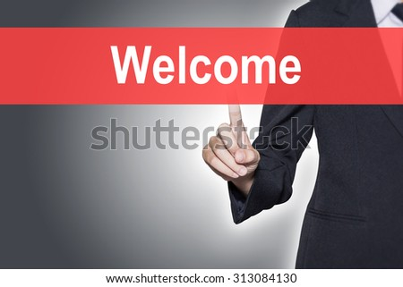 Welcome Business woman pressing hand word on virtual screen - stock photo