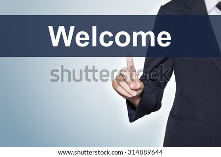 Welcome Business woman pushing hand on virtual screen for e-commerce background - stock photo