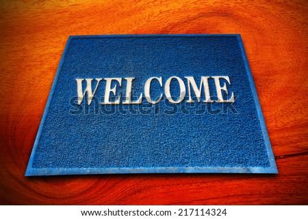 welcome doormat carpet on the floor - stock photo