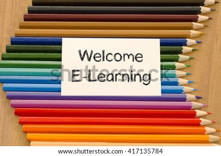 Welcome e-learning text concept and colored pencil on wooden background - stock photo