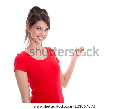 Welcome gesture: Young smiling isolated woman in red is showing something. - stock photo