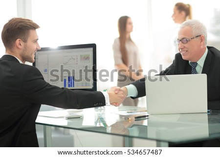 Welcome handshake before the start of negotiations at the office