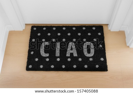 Welcome home black mat. Ciao - stock photo