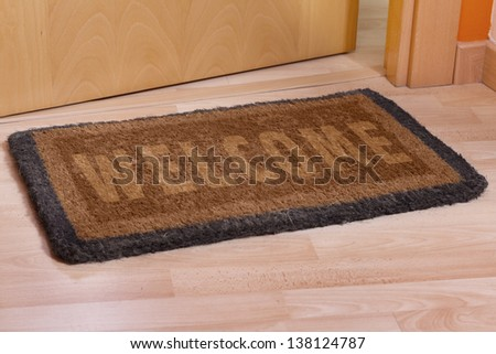 Welcome Home On Brown Mat