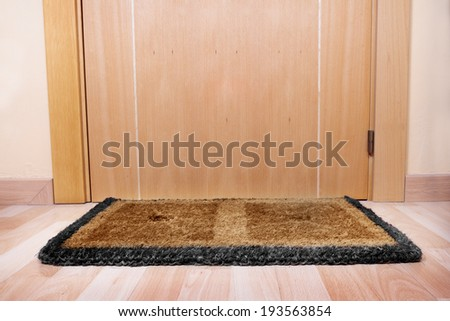 Welcome home on brown mat  - stock photo