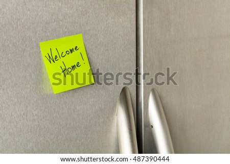 Welcome home sticky note on a home refrigerator.