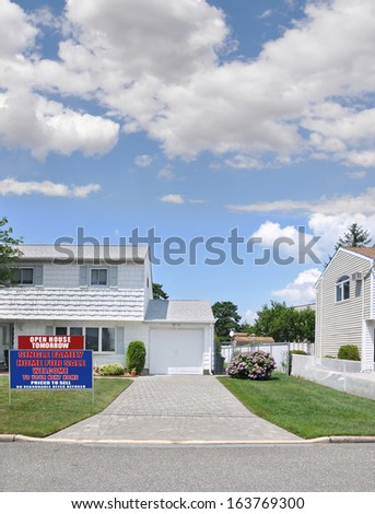 Welcome Open House Real Estate For Sale Sign Suburban Home Brick Driveway Rhododendrons Sunny Residential Neighborhood Street Blue Sky Clouds USA - stock photo
