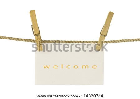 welcome paper hang on clothesline with clipping path - stock photo