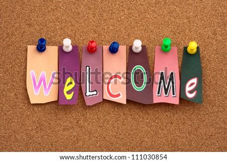 Welcome pinned on cork bulletin board - stock photo