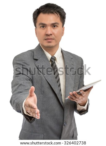 welcome portrait of young asian handsome businessman handshake & holding tablet pc on left hand, isolated on white - stock photo