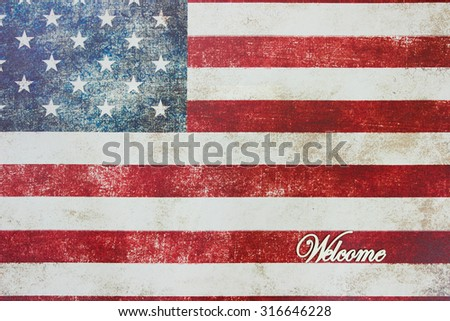 Welcome sign on vintage American flag background - stock photo