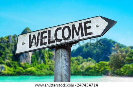 Welcome sign with a beach on background - stock photo