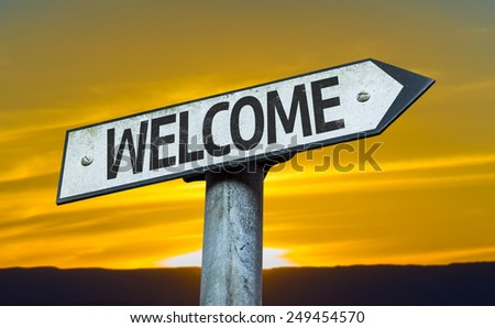 Welcome sign with a sunset background - stock photo