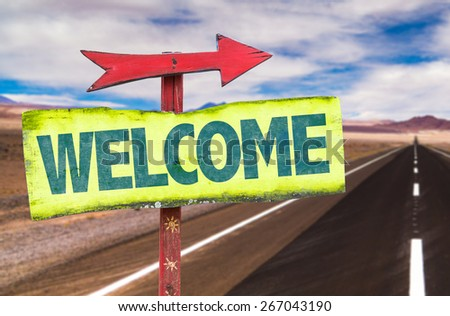 Welcome sign with road background - stock photo