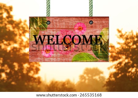 welcome signpost in beautiful woodland with vintage forest filter - stock photo